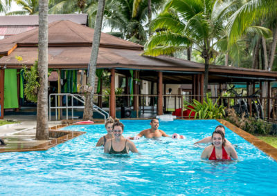 Guests swimming and exercising in pool